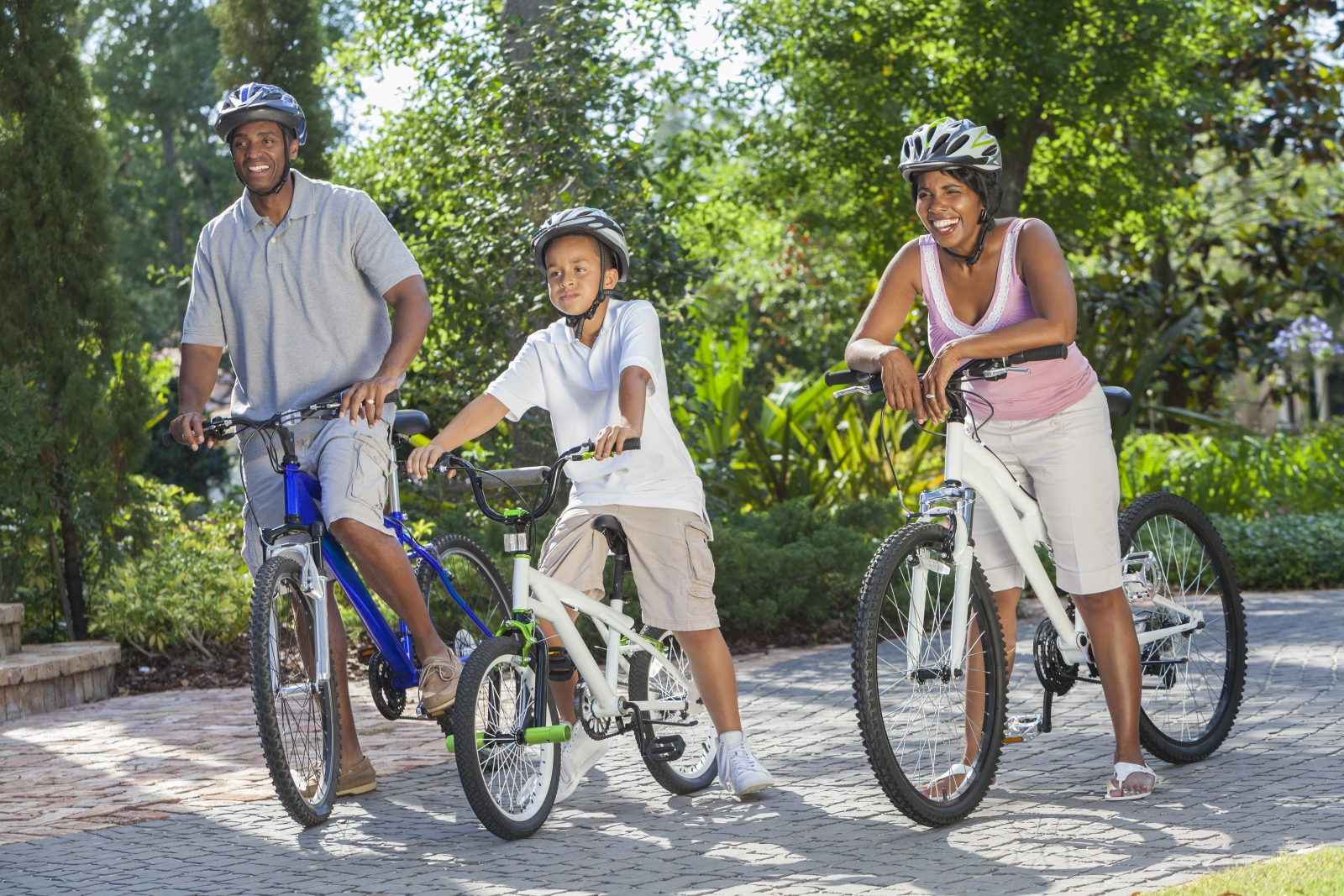 Mom, dad, & son on bikes wearing helmets shutterstock_117289561.jpg