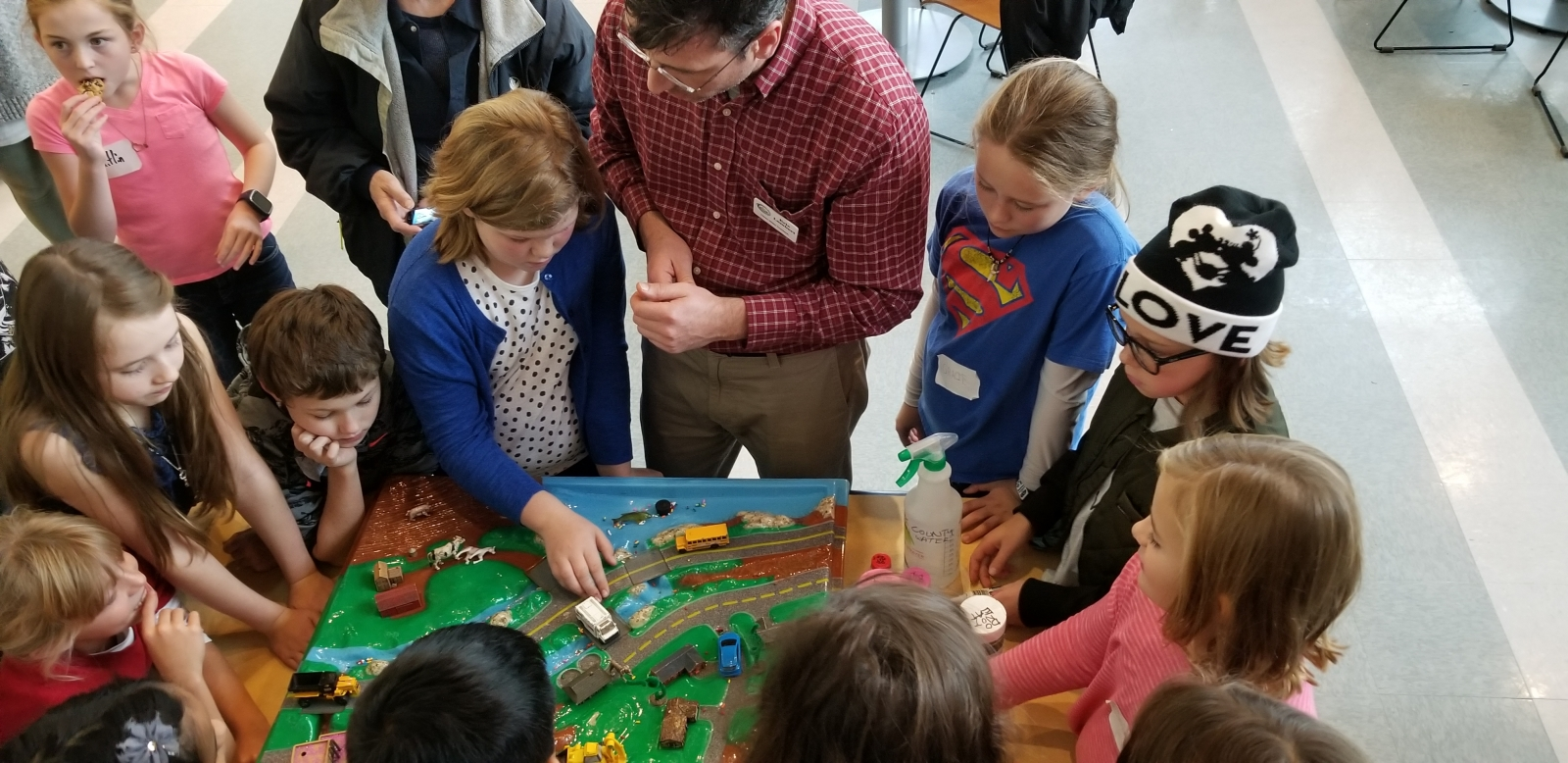 Students with Enviroscape watershed model