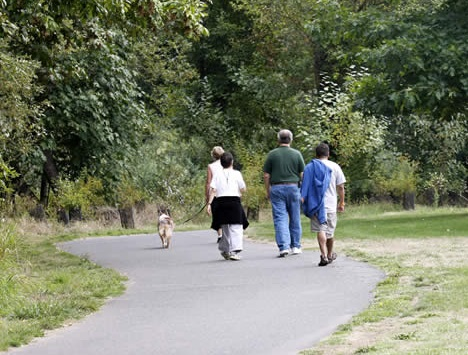 People walking on a paved trail.
