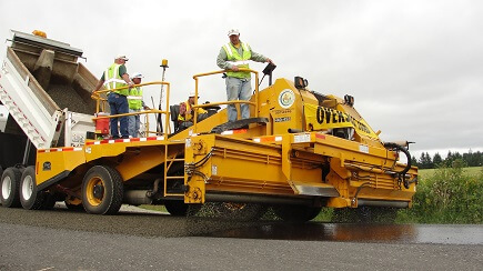 Chip sealing a road in north Clark County.
