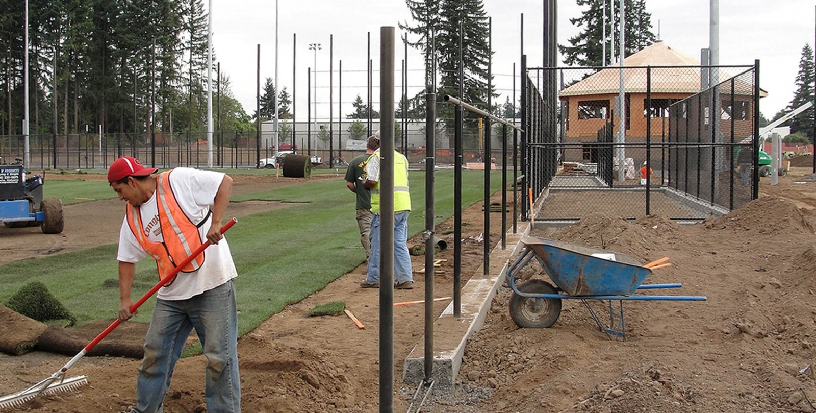 ​​Workers installing sod for a natural grass field during construction of Luke Jensen Sports Park in 2011.