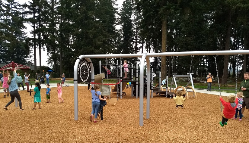 Children using the playground at Otto Brown Neighborhood Park.