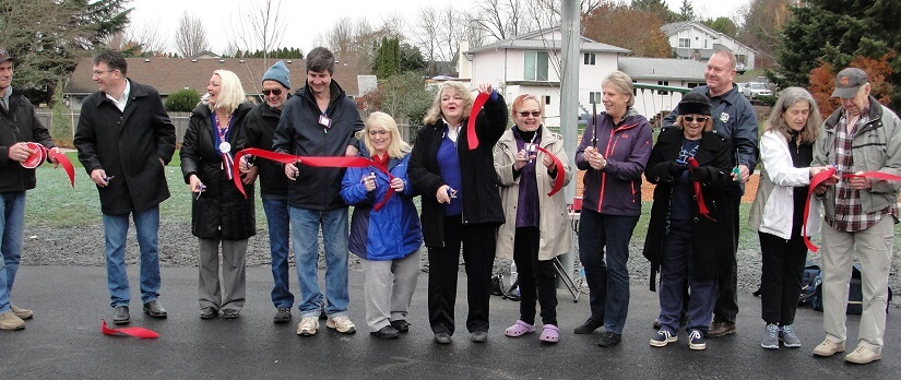 Members of the Felida Neighborhood Association cut a celebratory ribbon for the new park, Dec. 3, 2016.