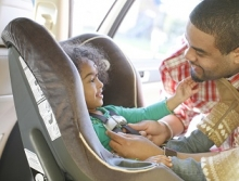 placing-child-in-car-seat.jpg